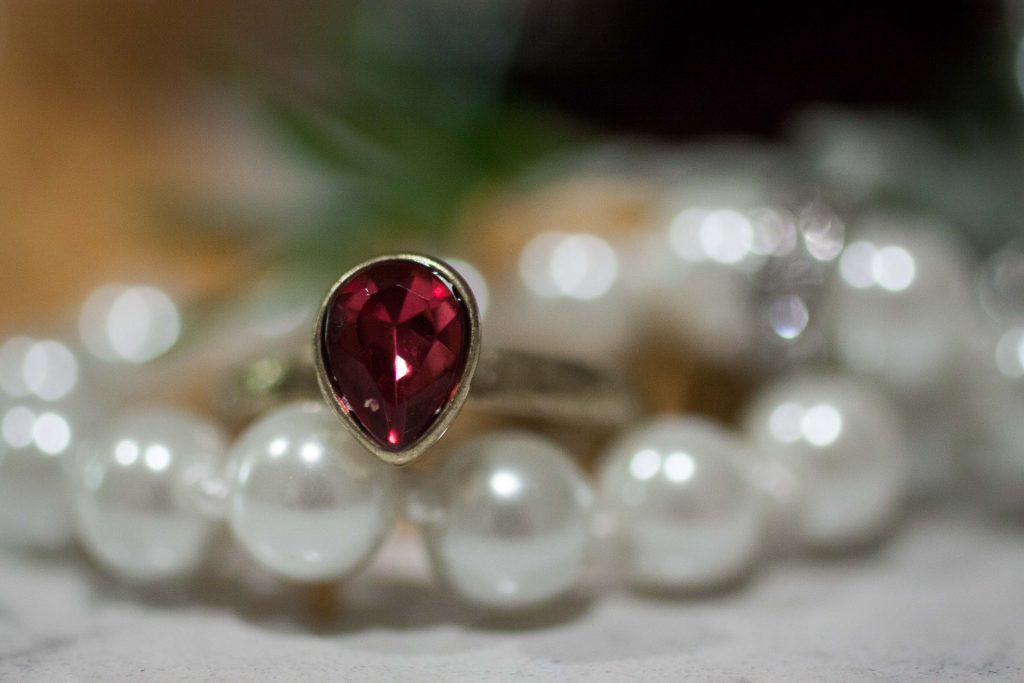 Jewel pear ruby ring with pearls wedding jewelry, bridal jewelry | Photo by Memories in Time