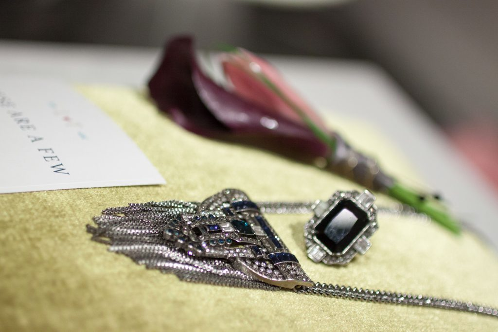 Bridal jewelry 1920s inspired blue stone pieces, engagement ring and necklace | Photo by Memories in Time Photography