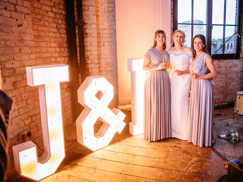 This couple's classy rustic reception held inside a old furniture warehouse was thoroughly inspired by all things antique and vintage.