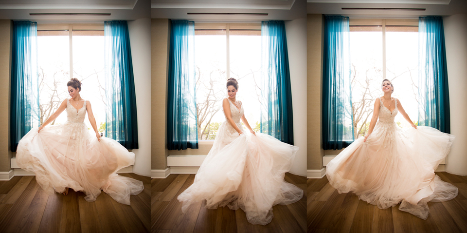 twirling with your dress in front of blue curtained windows