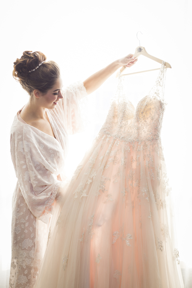 bride in a pretty robe with an updo