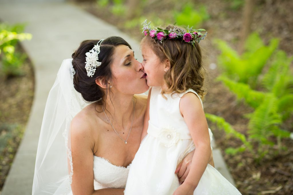 flower girl and mom the bride kiss | hair band and veil with bridal updo | Courtney June Photography | Minnesota wedding