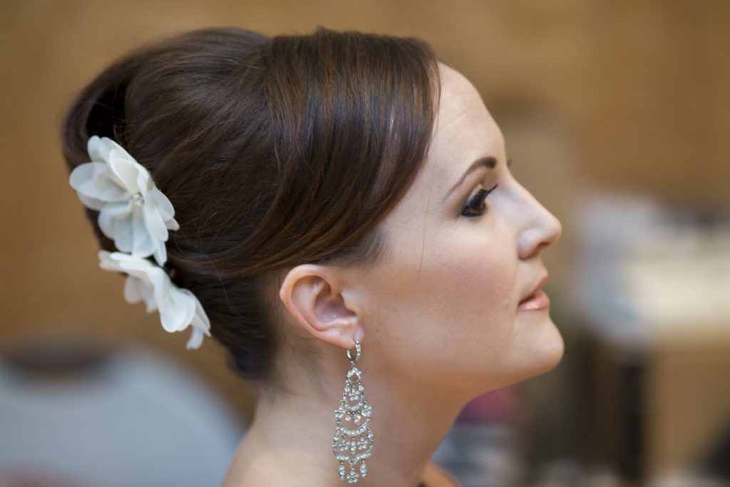bridal french twist updo | chandelier earrings | nude lip | Courtney June Photography