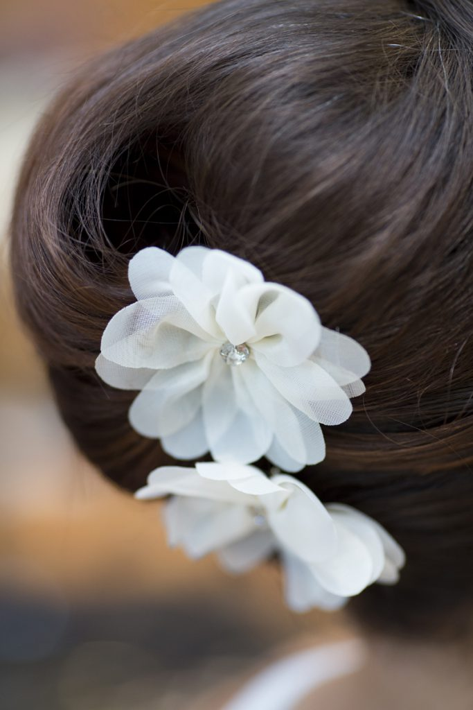 bridal french twist with flower pins | Courtney June Photography | Minneapolis wedding hair