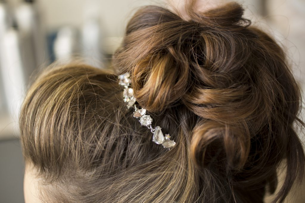bridal high bun with chunky curls and a bump in the front | Courtney June Photography | Minnesota hair and makeup