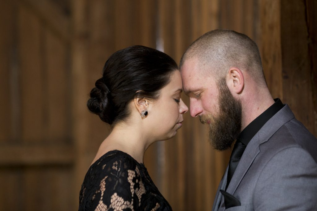 bride wearing dark lace with a twisted low bun | Courtney June Photography | Minneapolis wedding blog