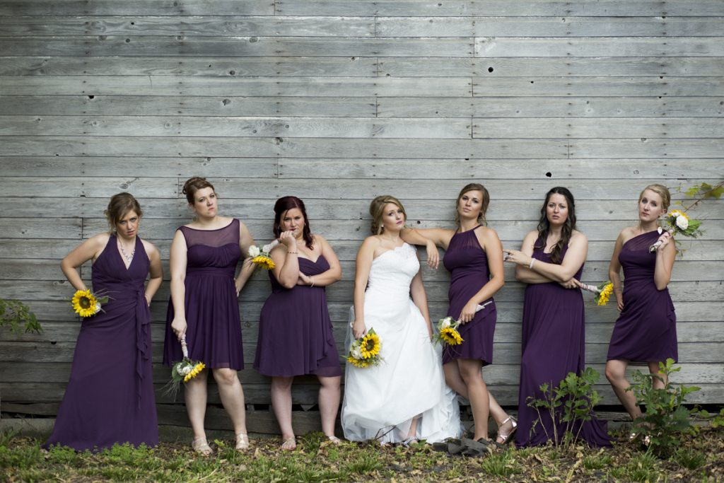 sassy bride with sunflower bouquet and eggplant dresses | Courtney June photography