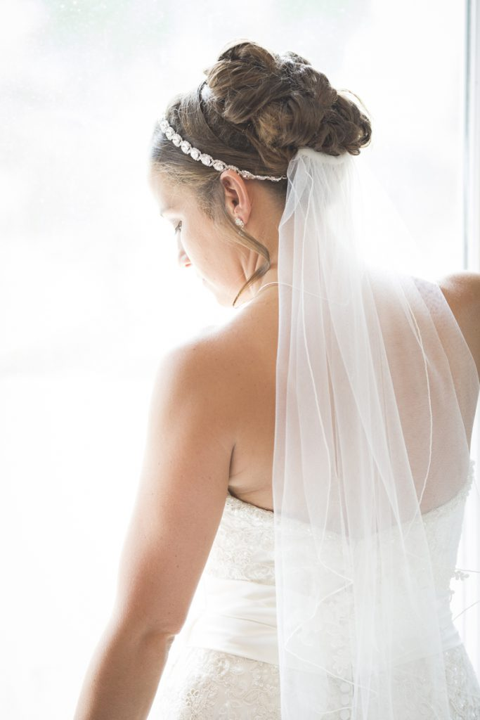 bridal updo with a veil and crystal headband | Courtney June Photography