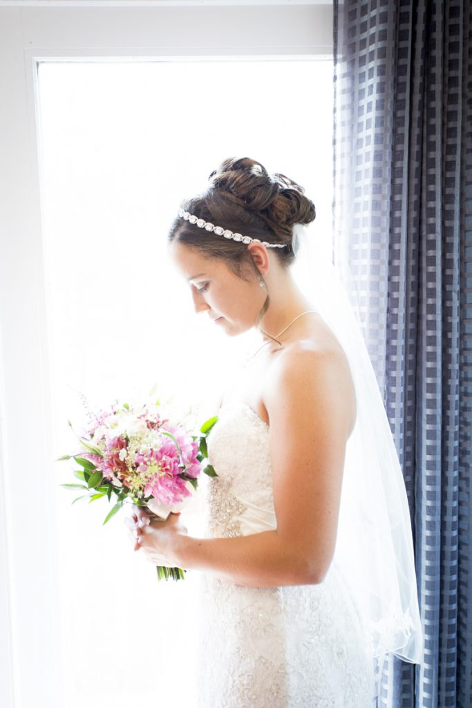 Bridal bun updo with strapless dress and headband | Courtney June wedding photographer in Minnesota