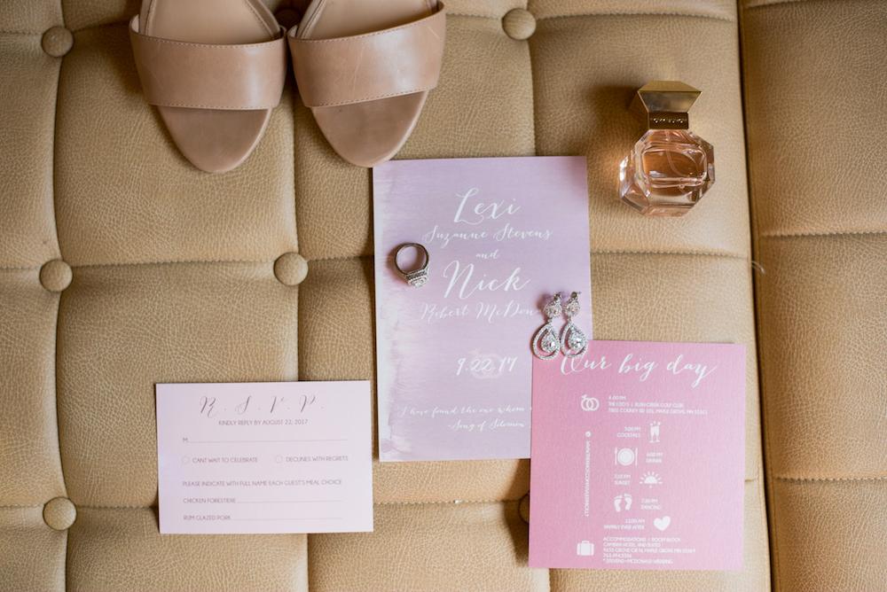 pinks invitation suit flat lay