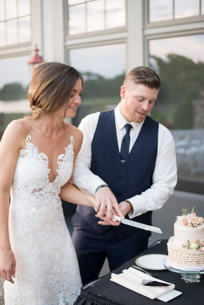 cutting the cake | groom in navy vest