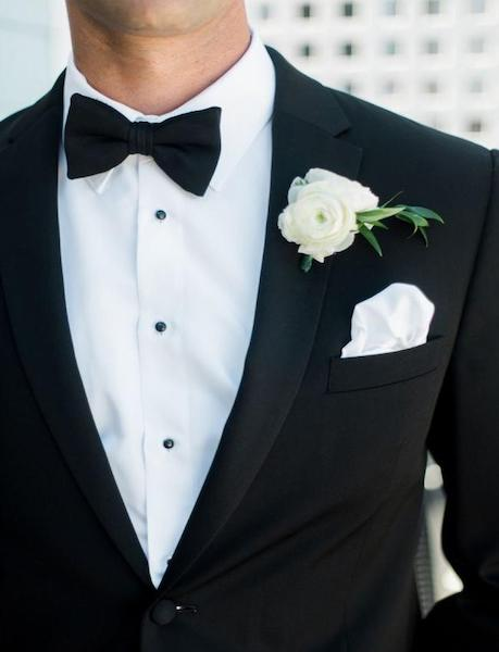 boutonniere and poorly folded pocket square