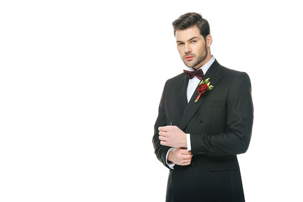 Groom - groom with red boutonniere - proper way to wear a boutonniere