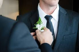 Groom - boutonniere - boutonniere pinned on the wrong side