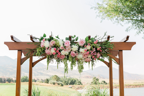 Perfect Wedding Guide - Denver Perfect Wedding Guide  - Denver wedding - mountain wedding - wedding arch with pink flowers