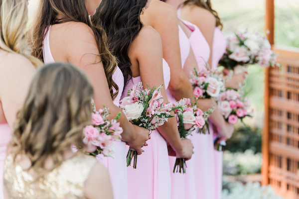 Perfect Wedding Guide - Denver Perfect Wedding Guide  - Denver wedding - mountain wedding - bridesmaids in pink dresses with pink flowers