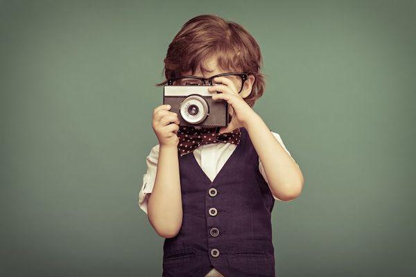 child holding a camera - look at your wedding photographers entire wedding gallery