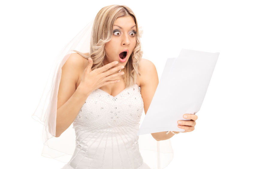 surprised bride - read your wedding contracts