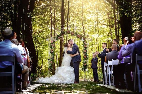 rustic outdoor wedding ceremony - wedding arch