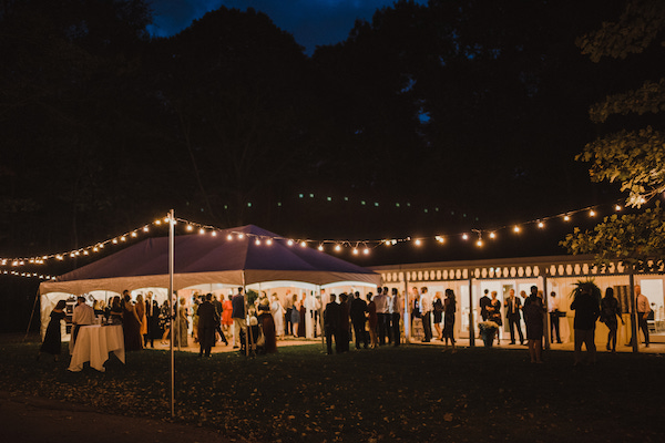 tented wedding reception- market lights - tented wedding at night