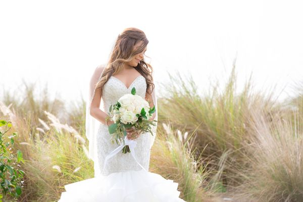 beautiful bride in lace wedding gown