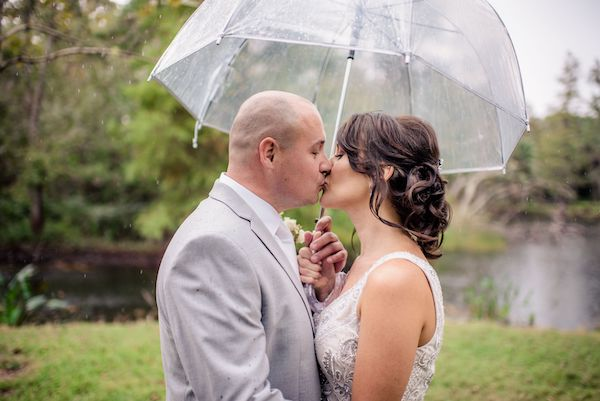 Orlando Perfect Wedding Guide - Orlando Real Wedding - bride and grounder an umbrella