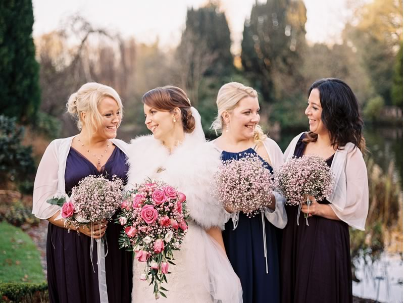bride and her bridesmaid in winter wedding shawls 10 Reasons why you Should opt for a Winter Wedding